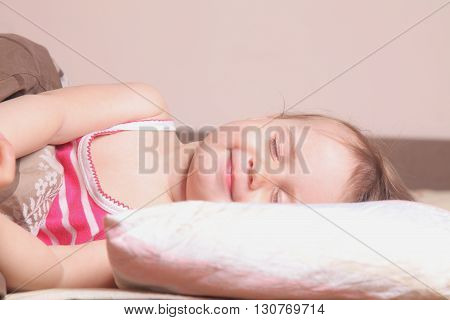 beautiful little baby girl sleeping and smiling (childhood security family)