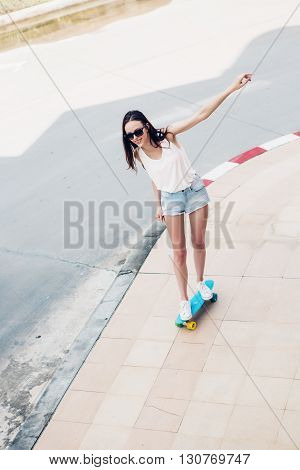 Hipster Girl With Skateboard On The Street.