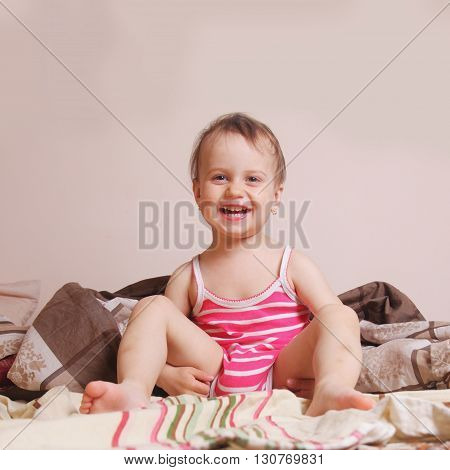 Happy smiling baby girl getting ready for bed (Childhood security family)