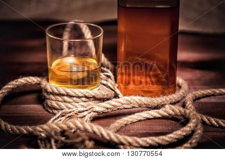 Glass Of Whiskey With Ice, A Bottle Of Single Malt Whiskeys