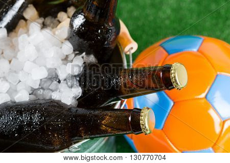 Football with a beer in a cold bucket