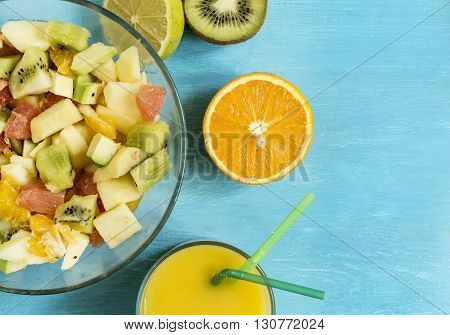 ripe juicy citrus fruit fruit salad juice ice on a blue wooden table top view
