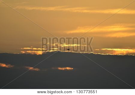 Small aircraft in flight at sunset over the river Florida, USA