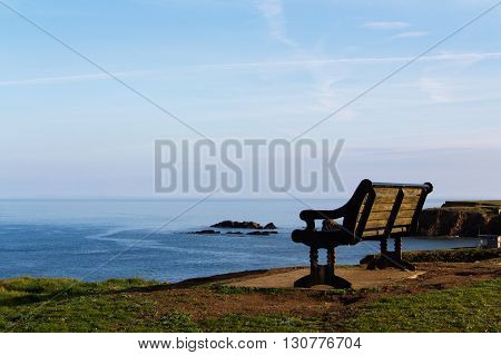 Empty Bench Over Looking The Coast In Bude, Cornwall
