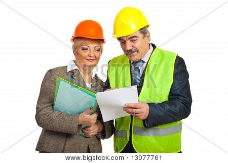 Mature Constructors Workers Reading Contract