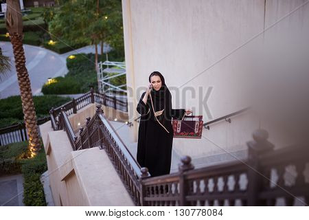 Attractive muslim woman enjoying shopping day in the city.