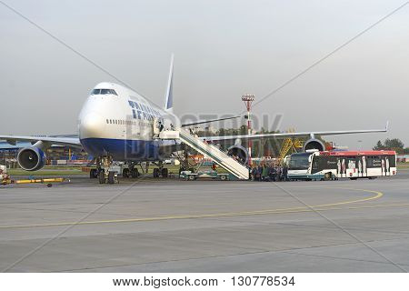 Passengers Board The Aircraft Boeing 747 Transaero Airlines