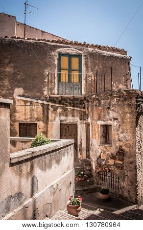Old houses in a small town on the coast of Sicily
