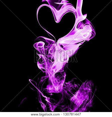 Purple smoke on black background from the incense sticks