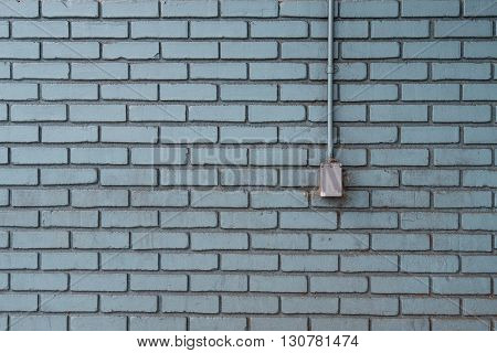 Metal Outlet on Aqua Painted Bricks with copy space