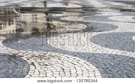 Floor of a street with stone tiles Lisbon Portugal.