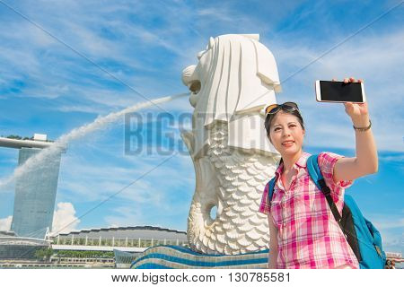 Smiling Young Woman Making Selfie Near Merlion Park