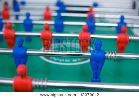 Plastic tabletop football with red and blue figures.