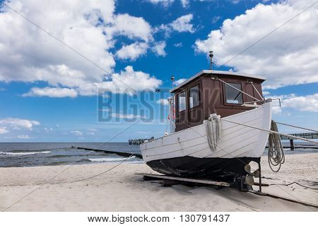 A fishing boat on shore of the Baltic Sea in Koserow (Germany).