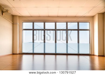 Perspective View Of Empty Studio Illuminated With Light From Windows
