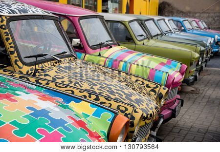Berlin Germany - January 19 2016: Colourfull vintage small cars for rent by tourists to travell around Berlin on January 19 2016 in Berlin Germany.