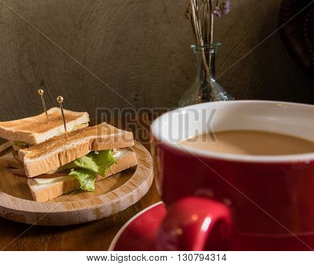 Cup Of Coffee And Saucer On Table With Toast