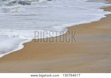 Ocean surf water foam on beach at Florida, USA