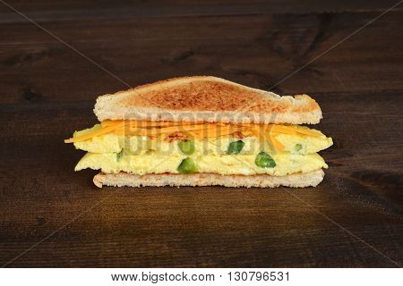 closeup of a toasted western sandwich on wood