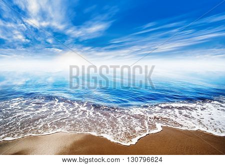 picture of a beach under a blue sky