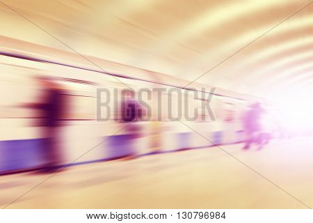 Abstract image of motion blurred people at subway station.