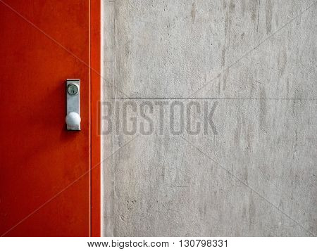 Cement concrete wall texture with modern red door.