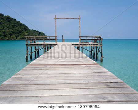 Jetty into blue sea and sky. Pier over water. Vacation And tourism concept. Tropical resort. Jetty on Koh Kood Island Thailand.