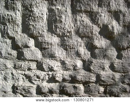a picture of an exterior 19th century adobe building wall