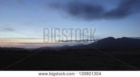 Silhouettes of Snowdonia mountains in North Wales just after sunset.