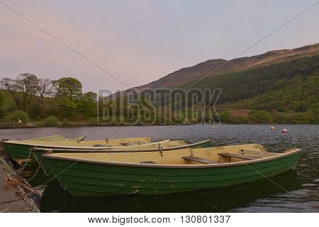 A couple of boats on Tal-y-Llyn lake in Snowdonia North Wales at sunrise.