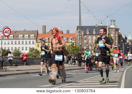 Copenhagen, Denmark - May 22, 2016: A runner dressed as a viking at the yearly event Copenhagen Marathon.