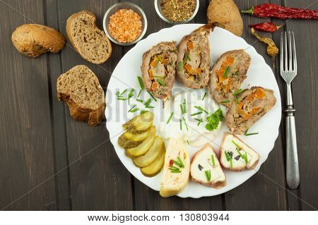 Baked roll with minced meat, cheese rolls and mayonnaise. Homework refreshments at the party.