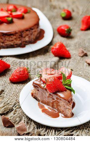 milk chocolate cheesecake with milk chocolate icing and strawberries