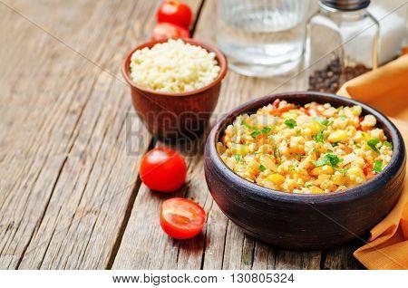 red pepper cilantro corn millet on a dark wood background
