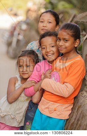 KATHMANDU, NEPAL, NOVEMBER 3, 2010 : A group of little girl is posing in a narrow street of Kathmandu city in Nepal.