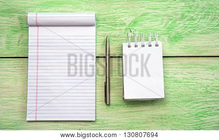 Spiral notebook. White blank notebook on grunge wood