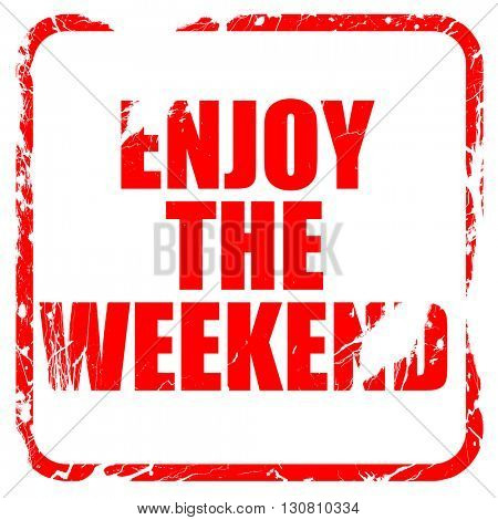 enjoy the weekend, red rubber stamp with grunge edges
