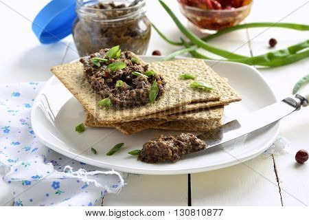 Mushroom pate and dried tomatoes with crackers mousse
