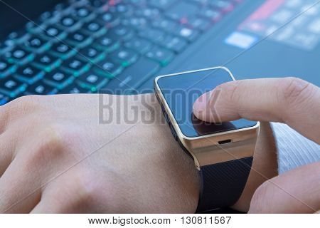 Business Man Using His Smartwatch App Near Computer Pc Keyboard On Daily Light