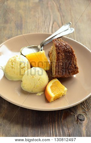 Orange cake with walnuts and ice cream, vertical