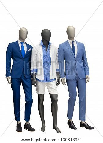 Three man mannequins dressed with fashionable modern clothes isolated on white background. No brand names or copyright objects.