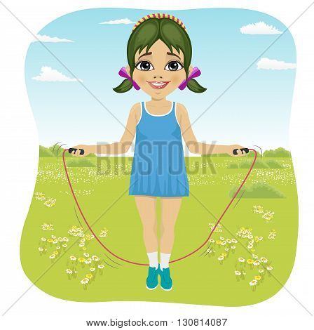 Seven years girl jumping with skipping rope in the summer park