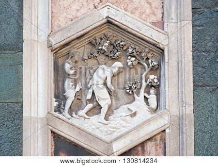 FLORENCE, ITALY - JUNE 05: Adam and Eve working after the Fall by Andrea Pisano, 1334-36., Relief on Giotto Campanile of Cattedrale di Santa Maria del Fiore, Florence, Italy on June 05, 2015