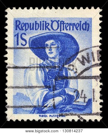 ZAGREB, CROATIA - SEPTEMBER 13: A stamp printed in Austria shows image woman in national Austrian costumes, Tyrol, Puster Valley, series, circa 1948, on September 13, 2014, Zagreb, Croatia