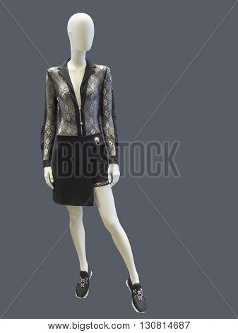 Female mannequin dressed in fashionable clothes Isolated on white background. No brand names or copyright objects.