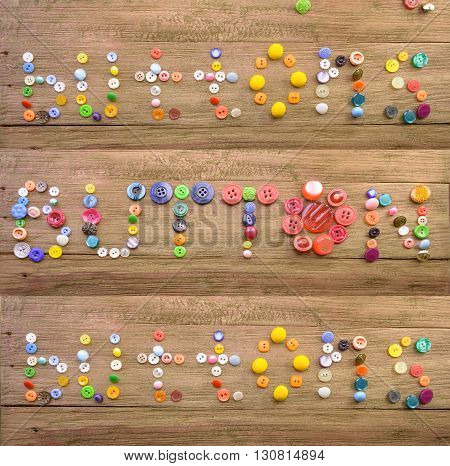 macro inscription the text the word a button laid out by multi-colored buttons on a wooden background in three options