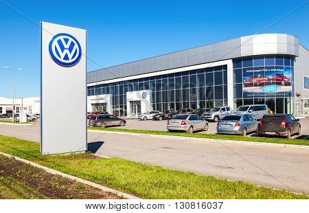 SAMARA RUSSIA - MAY 14 2016: Dealership sign and cars parked up near the office building of official dealer Volkswagen. Volkswagen Group is the biggest German automaker