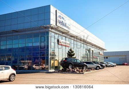 SAMARA RUSSIA - MAY 14 2016: New cars parked up near the office building of official dealer Mitsubishi. Mitsubishi Motors Corporation is a multinational automotive manufacturer