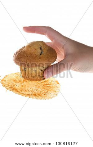 Female Hand Catch Chocolate Muffin Against White Background
