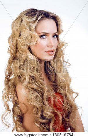 beauty blond woman with long curly hair close up isolated, hairstyle waves, holiday people concept